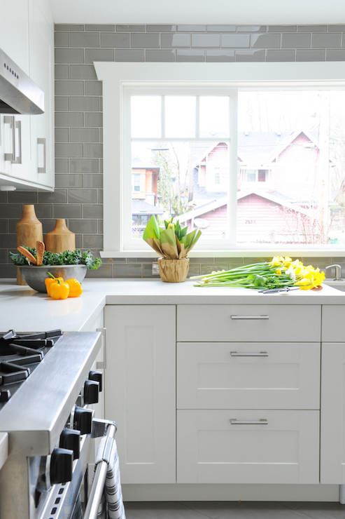White kitchen with grey backsplash transitional kitchen for Backsplash for white cabinets and grey countertops