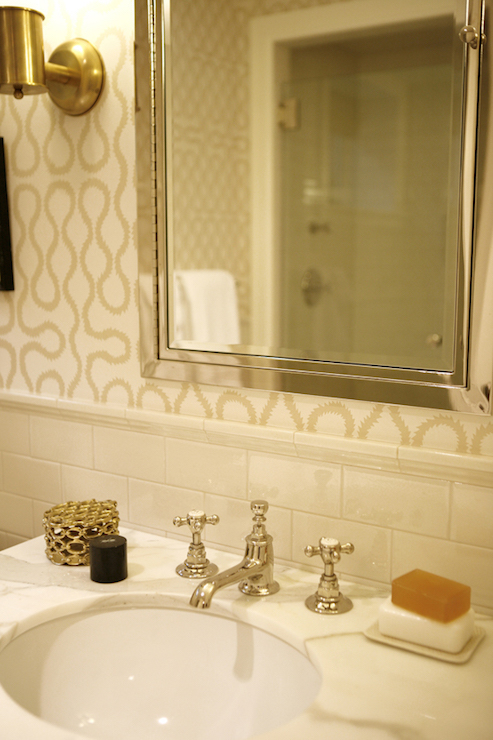 white and beige bathroom features upper walls clad in white and beige print wallpaper and lower walls clad in ivory subway tile backsplash finished with - Bathroom Subway Tile Backsplash