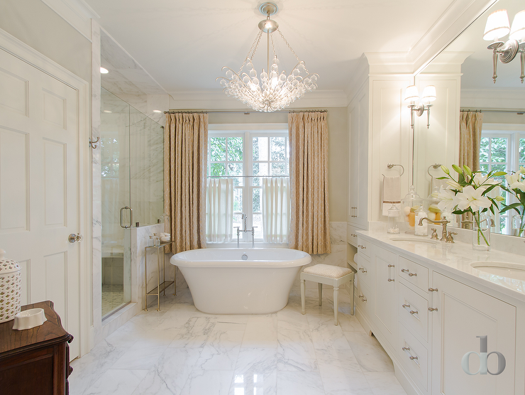 Tub Below Chandelier Transitional Bathroom