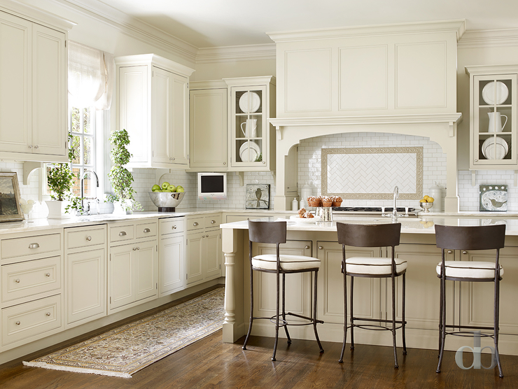 Ivory Kitchen Cabinets Part - 22: Sophisticated Kitchen Boasts Ivory Shaker Cabinets Paired With White Marble  Counters And A White Mini Subway Tiled Backsplash Accented With Dark Grout.