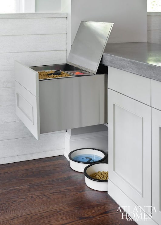 Kitchen Boasts A Small Nook Filled With Pert Food Bowls Tucked Under A  Pull Out Pet Food Storage Drawer Topped With Thick Concrete Countertops.