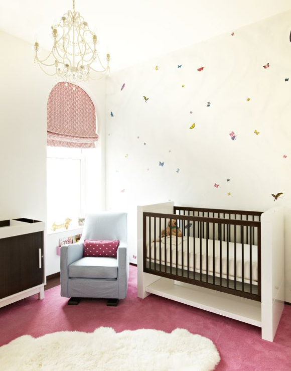 Pink And Blue Nursery Design Features An Accent Wall Clad In Butterfly  Decals Over A Two Tone Crib Next To A Blue Glider Atop A Pink Rug Under An  Arched ...