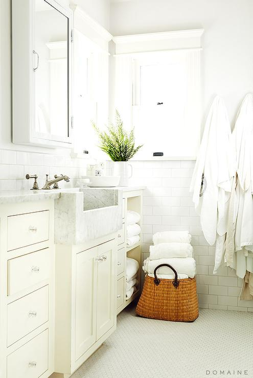 Sun filled bathroom features ivory cabinets adorned with crystal knobs topped with carrera marble framing a white marble apron sink and satin nickel faucet ... & Half Tiled Bathroom Backsplash Design Ideas