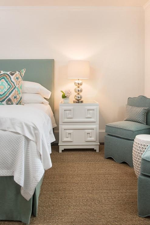 White And Sage Green Bedroom Features A Headboard On Bed Dressed In Soft Bedding Pleated Bedskirt Next To Greek