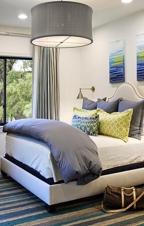 Headboard between wall sconces contemporary bedroom - Over the bed art ...