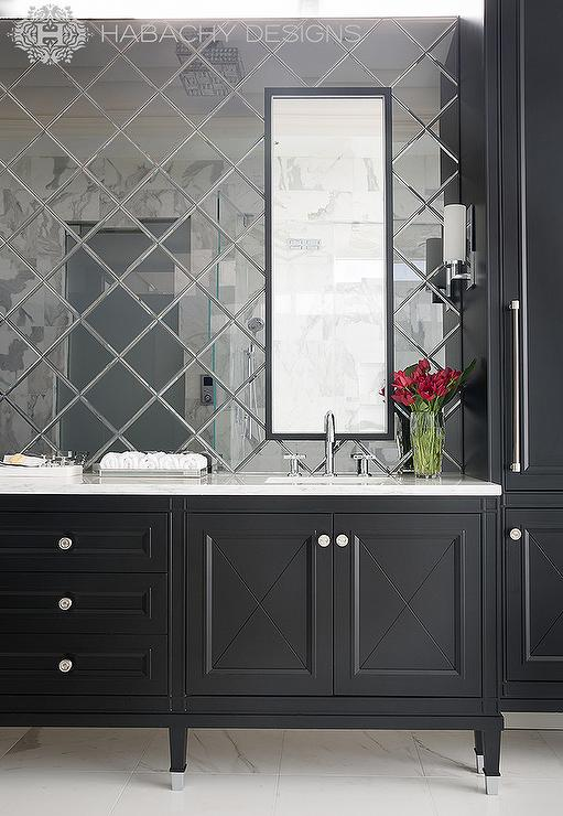 Stunning Master Bathroom Features A Black Dual Vanity With Feet Which Is Topped White Marble Under Tall Mirrors Mounted In