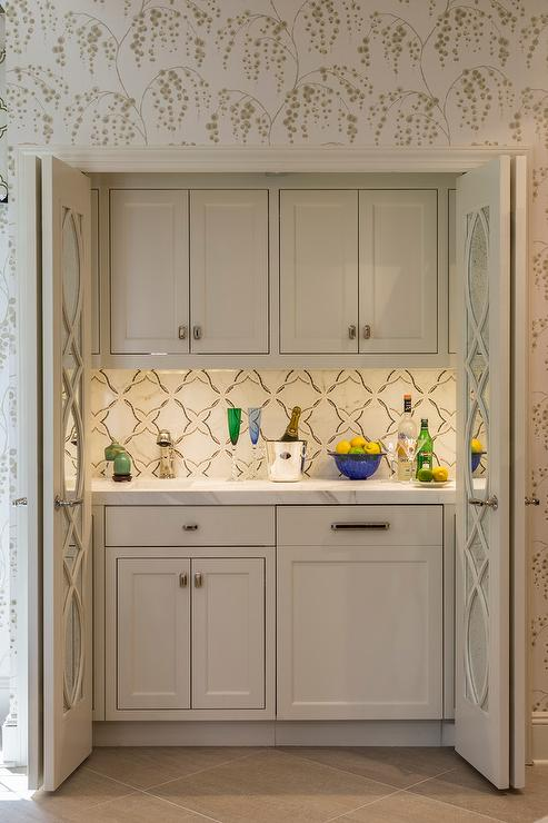 Wet Bar Hidden Behind Mirrored Folding Doors - Transitional - Living ...