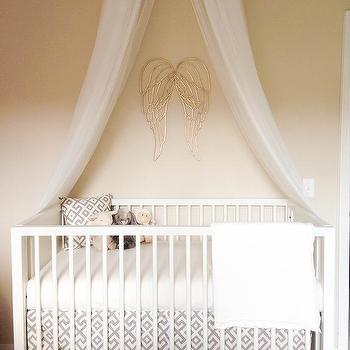 Nursery with Gold Angel Wings & Canopy Crib Design Ideas