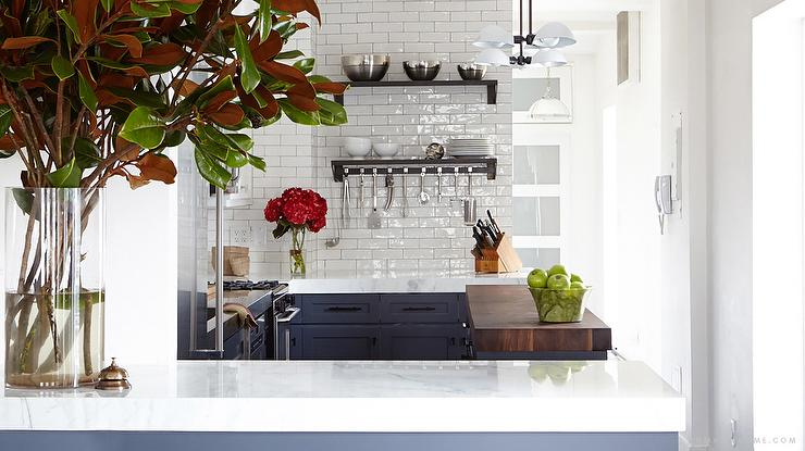 Fabulous Kitchen Features White Top Cabinets And Navy Bottom Cabinets Paired With Stainless Steel Countertop Alongside A White Glazed Tiled Backsplash