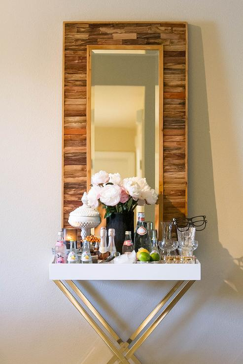 Lovely Dining Room Bar Boasts An X Based Tray Table, West Elm Tall Butler Tray  Stand, With White Lacquer Tray Top Filled With Libations Along With A  Reclaimed Wood ...
