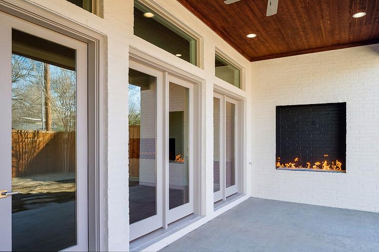 Covered Patio With Modern Fireplace Transitional Deck