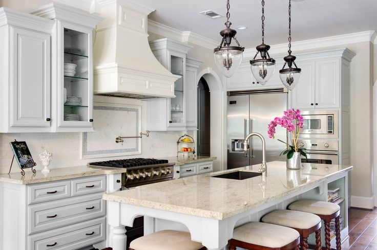 French Kitchen Features Gray Cabinets Paired With Cream Granite Countertops  And A White Subway Tiled Backsplash.