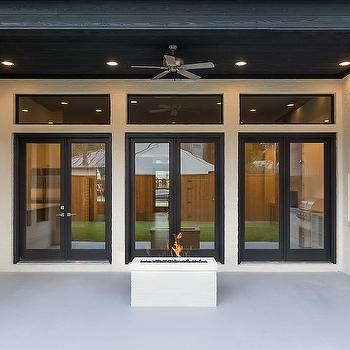 Superbe Covered Patio With River Rock Fireplace