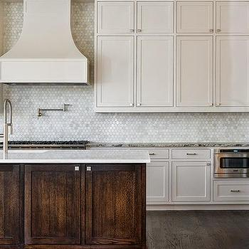 white shaker cabinets paired with grey granite countertops and a