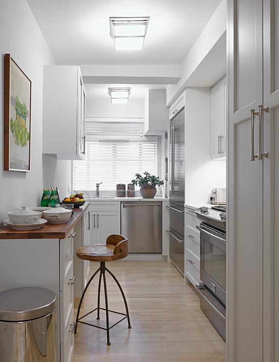Small white kitchens transitional kitchen for Small narrow kitchen designs