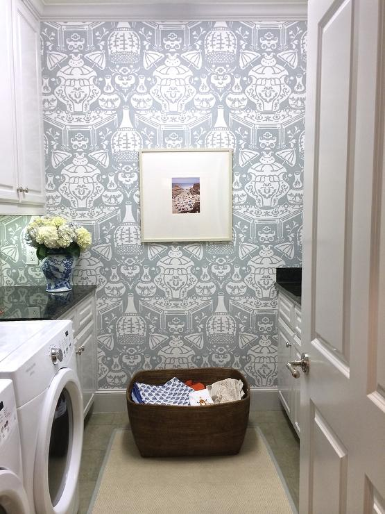 Beautiful laundry room features walls clad in david hicks for Front room feature wallpaper