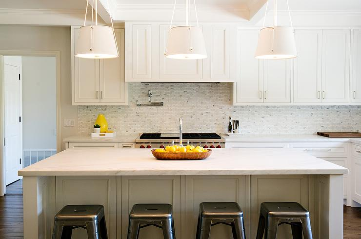white kitchen with white mosaic marble backsplash transitional