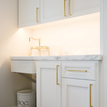 White Cabinets With Long Brass Pulls