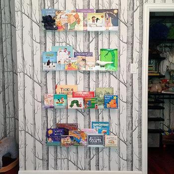 Nursery With Clear Floating Bookshelves