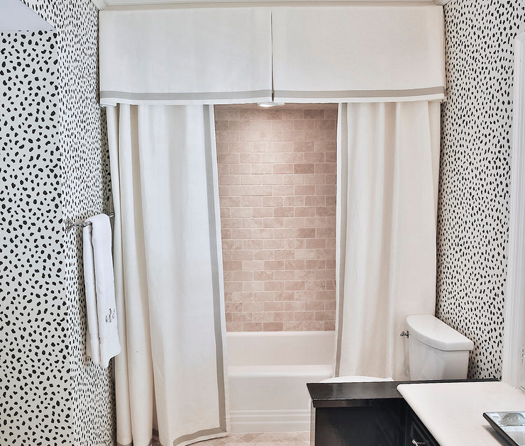 Beautiful Chic Bathroom Features A Drop In Tub Fitted With Tumbled Brick Tile  Surround Finished With A White Pleated Valance With Gray Ribbon Trim With  Matching ...