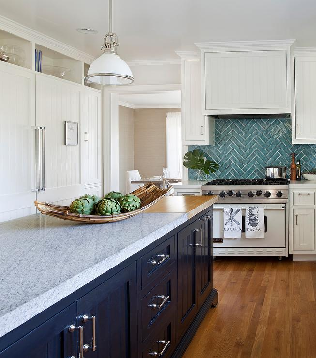 A white beadboard kitchen hood stands over