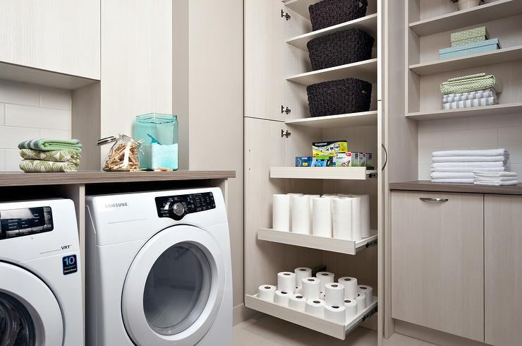 Amazing laundry room features an enclosed washer and dryer situated ...