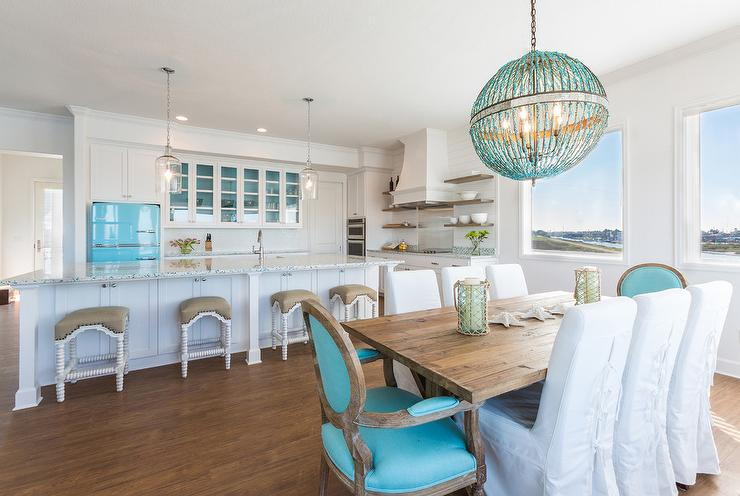 Turquoise blue beaded chandelier transitional kitchen cbs chic cottage kitchen features a pair of corsica pendants illuminating an extra long center island with legs fitted with recycled glass countertops framing aloadofball Image collections
