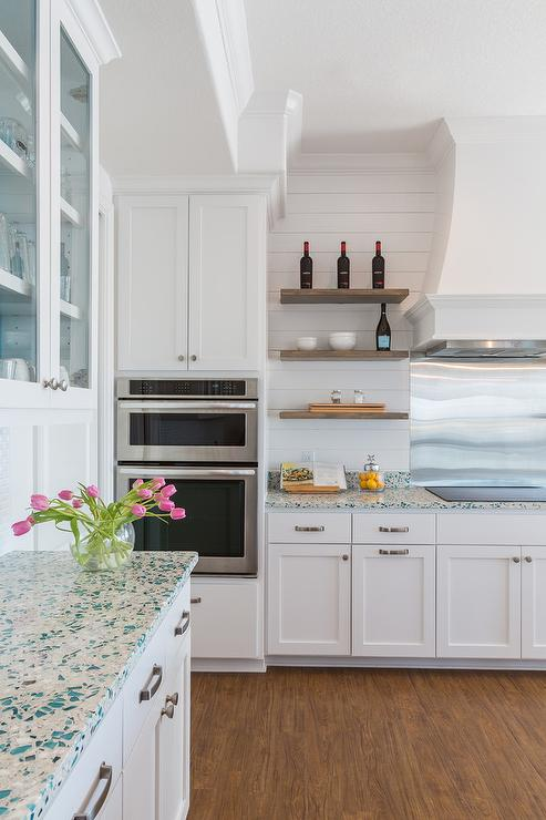 cottage kitchen features glass front upper cabinets and white lower