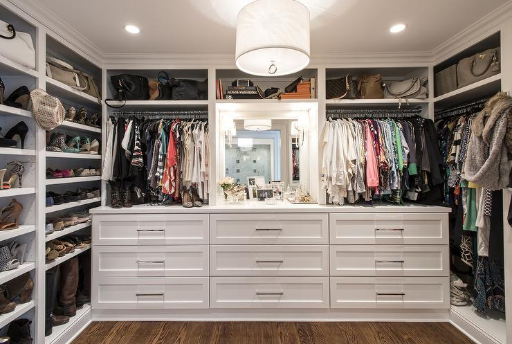 Walk in closet with built in dressers