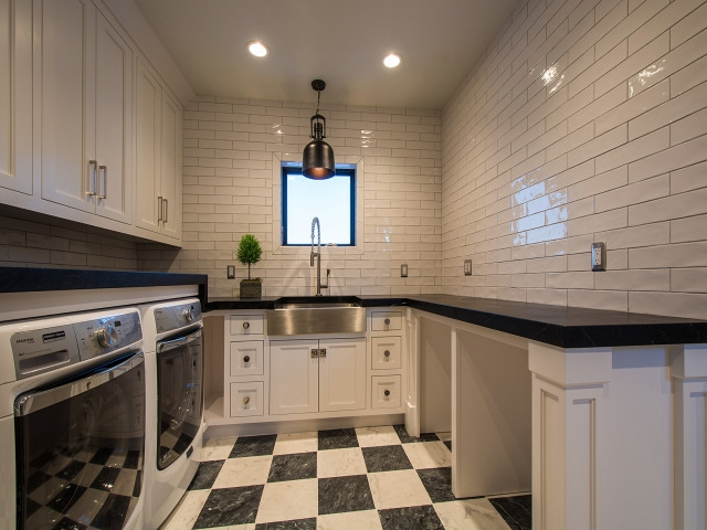 Laundry Room With Checkered Floors Transitional
