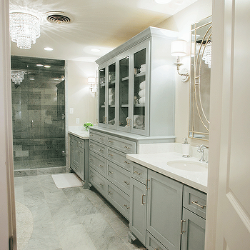 French Bathroom With Glass Front Linen Cabinet