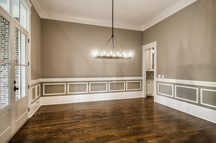 view full size  Amazing dining room features walls painted gray accented with white wainscoting and chair rail alongside glass Dining Room With Chair Rail Design Ideas