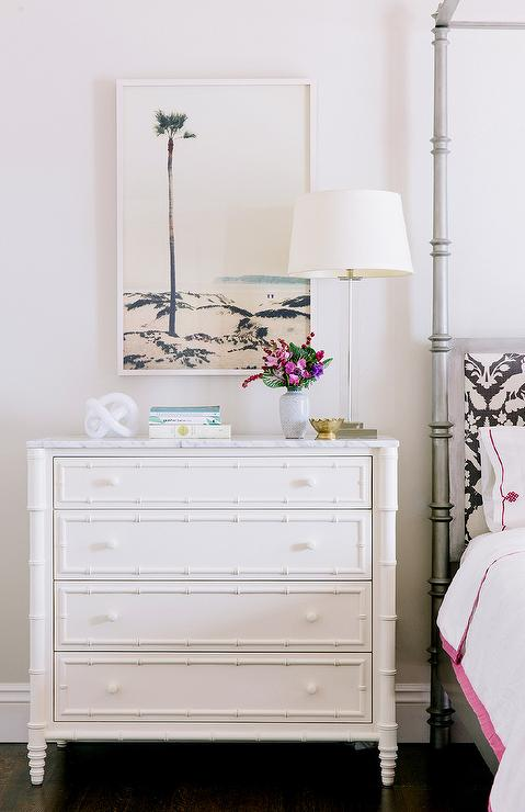 bedroom with white bamboo nightstand