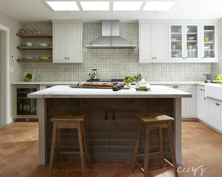 ... Cottage Kitchen Features Four Skylights Situated Over A Plank Island  Topped With White Marble Lined With Saddle Stools Atop A Terracotta Hex Tile  Floor.