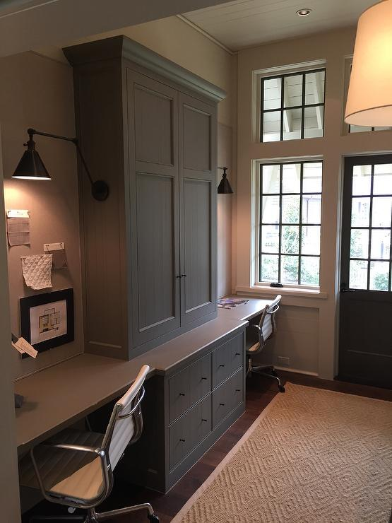 built in desks for home office. home office for two features gray cabinets adorned with bronze knobs flanked by builtin desks countertops lined eames management chairs built in