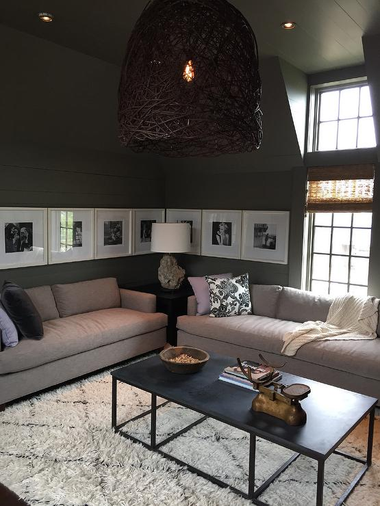 Chic Living Room Features Gray Paneled Walls And Ceiling Dotted With Pot Lights A Twig Birds Nest Light Pendant Illuminating Pair Of One Cushion