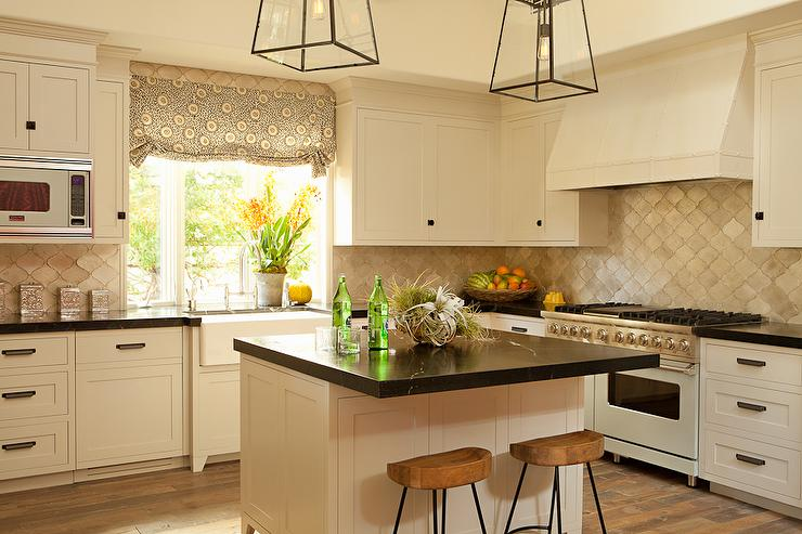 Cream kitchen features cream shaker cabinets paired with black marble