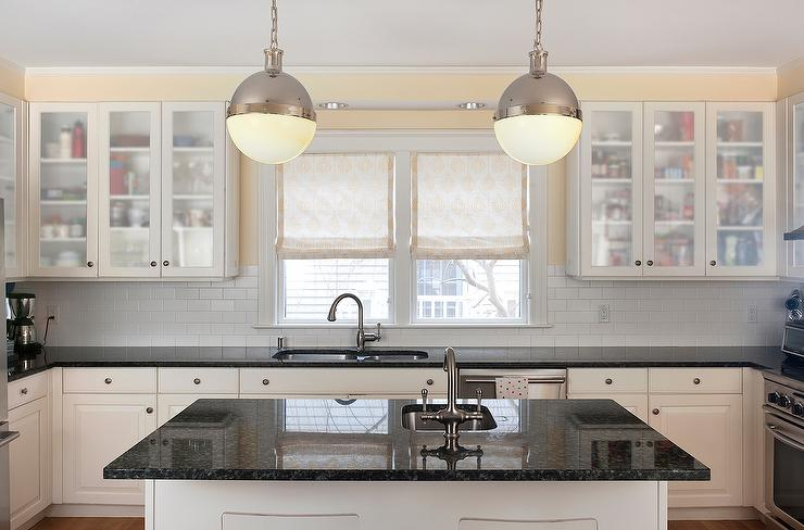 Cream kitchen cabinets with black countertops - Black granite countertops with cream cabinets ...