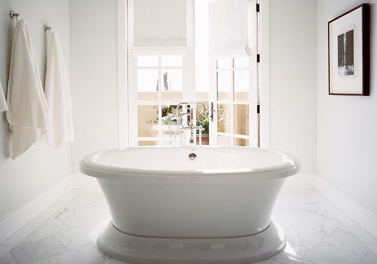 Tub In Front Of French Doors