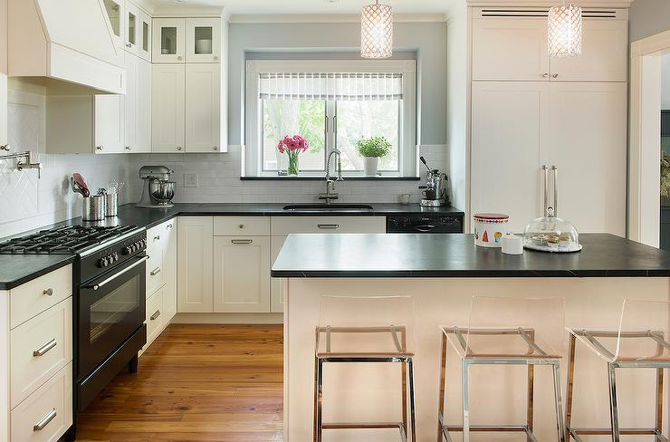 Cream kitchen cabinets with soapstone countertops for What kind of paint to use on kitchen cabinets for marriage wall art