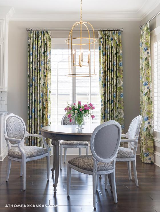 Fabulous Dining Room Features A Gold Leaf Lantern Illuminating Round French Table Lined With Back Chairs Upholstered In Gray