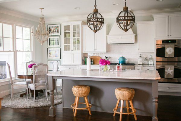 French Inspired Kitchen Features A Pair Of Vintage French Lanterns  Illuminating A Gray Kitchen Island With Turned Legs Topped With Curved  White Marble Lined ...