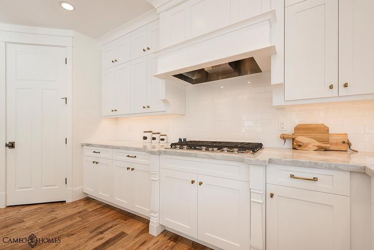 White Kitchen Cabinets with White Subway Tiles - Transitional - Kitchen
