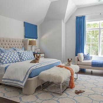 blue and beige bedroom features a beige velvet tufted wingback bed