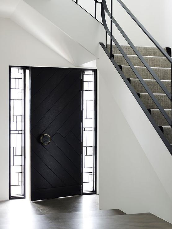 Black herringbone front door geometric sidelights door under staircase
