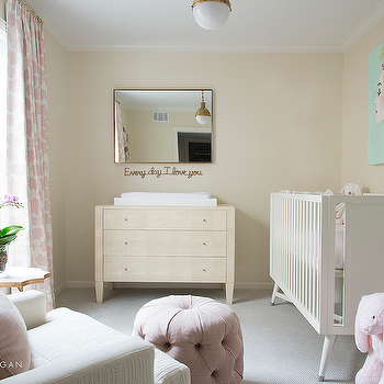 Pink Nursery With White Dresser And Changing Table