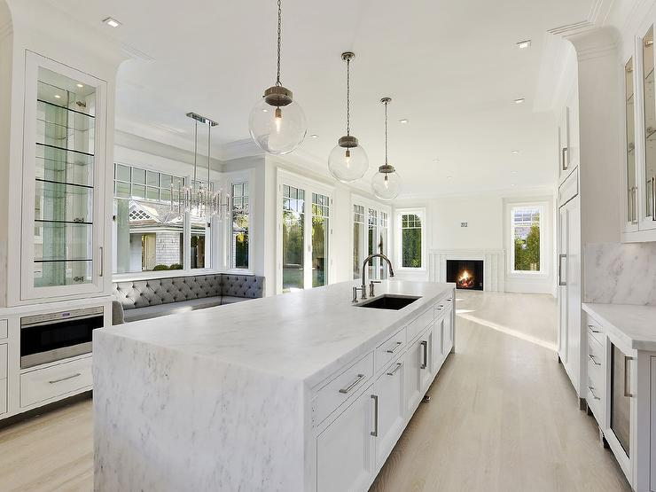 Superb Stunning Kitchen Features A Window Seat Nook Filled With An U Shaped Gray  Tufted Dining Banquette Illuminated By A Jonathan Adler Meurice Chandelier  Flanked ...