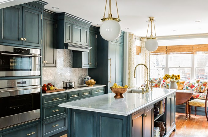 Country Kitchen Features Blue Wash Cabinets Accented With Gold Hardware  Paired With White Marble Countertops And A Marble Hex Tiled Backsplash.