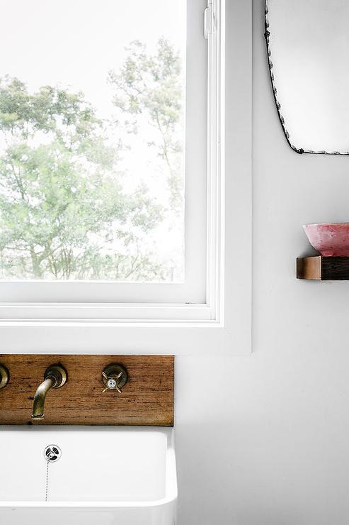 Window Over Bathroom Sink Cottage Bathroom - Bathroom sink spigots