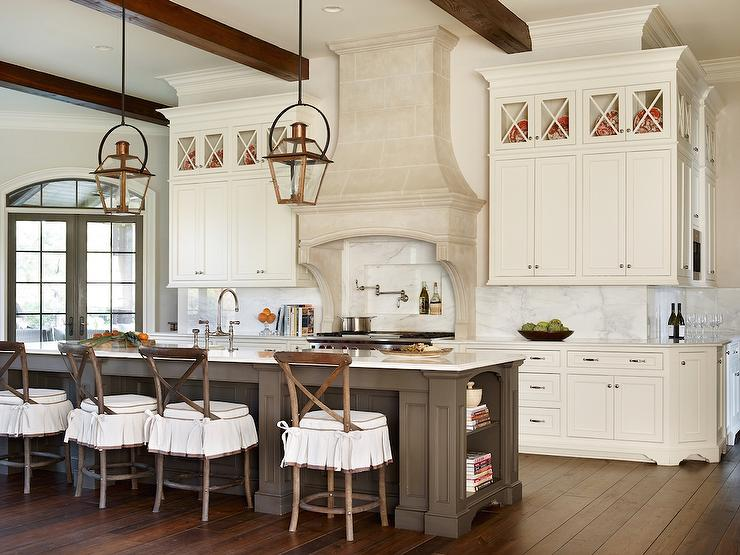 Perfect French Kitchen Features A Pair Of Copper Lanterns Illuminating A Long Gray  Center Island Fitted With End Cookbook Shelves Topped With Contrasting  White ...